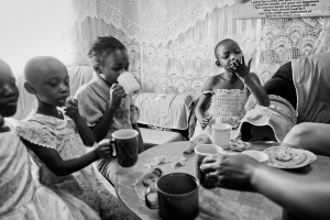 The soap sellers' daughters enjoying some traditional chai and chapatis (in Kibera)